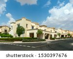 Villas compound development in a bright sunny day with white clouds in the blu sky
