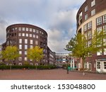 Amsterdam Urban City Scene with Apartments and Trees - stock photo