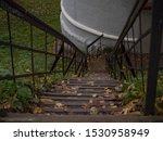 An Old Metal Staircase Runs...