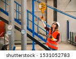 Young Businesswoman Holding An...