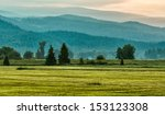 green mountains and grass in... | Shutterstock . vector #153123308
