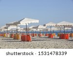 White Parasols With Yellow And...