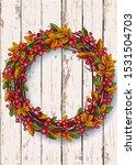 autumn wreath on a wooden... | Shutterstock . vector #1531504703