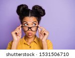 Small photo of Photo of amazing dark skin lady sending air kisses touching eyeglasses looking wondered empty space listen rumours wear yellow shirt isolated purple color background