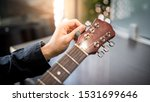 Male Hand Guitarist Adjusting...