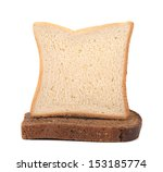 Sailboat made ??of white and brown bread. - stock photo