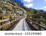 Historic Trestle Bridge. Myra Canyon in British Columbia, Myra Canyon is a popular tourist attraction featuring a cycling and hiking trail following the historical route of the Kettle Valley Railway.