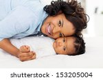 cute young african mother and... | Shutterstock . vector #153205004
