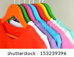 different shirts on colorful... | Shutterstock . vector #153239396