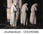 Hooded Monks Walking In A Dark...