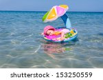 The Baby Sleeps In A Float At...