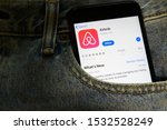 mobile phone with airbnb logo... | Shutterstock . vector #1532528249
