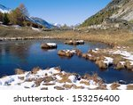 Small photo of Lake and mountains in french alps near the Monal village, in Vanoise national park. France