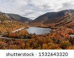Artists Bluff in New Hampshire in the fall. Stunning views from above of the foliage inspiring others to visit New Hampshire. Located in Franconia Notch State Park.