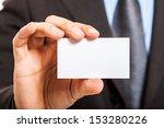 man holding a blank business... | Shutterstock . vector #153280226
