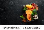 autumn vegetables on a black...