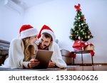 cute caucasian couple lying on... | Shutterstock . vector #1533060626