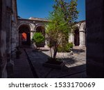 Colonial style architecture in a inner courtyard of rooms with central tree.  Saint Catherine Monastery (Convento de Santa Catalina), Arequipa City, Peru