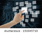 Woman hand using touch screen interface on circuit board background  - stock photo