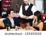 couple ordering dinner in a... | Shutterstock . vector #153353333