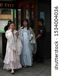 Small photo of Suzhou, China June 13, 2019 Two young women in traditional clothing in the garden of the humble administrator