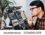 Technician Reparing A Broken...