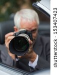 mature paparazzi taking picture ... | Shutterstock . vector #153407423