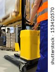 Closeup of a yellow forklift with an operator - stock photo