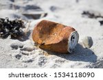 A Old Rusty Can On The Beach