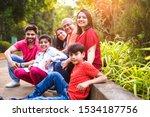 Indian Family Enjoying Picnic   ...
