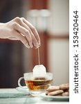 human hands making tea | Shutterstock . vector #153420464