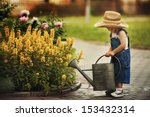 Cute Little Boy Watering...