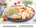 fried pork chops with tomatoes... | Shutterstock . vector #1534332050