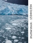 Small photo of Close-up of edge of blue glacier and calving ice or ablation in the Alaskan ocean waters