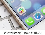 Small photo of Portland, Oregon, USA - Oct 17, 2019: Slack mobile app icon is seen on a smartphone. Slack is a B2B software, workplace messenger, team communication tool or platform.
