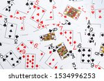 Small photo of Deck of playing cards shuffled at random shot from directly above