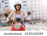 Woman Riding Scooter In The...