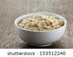 Bowl Of Oats Porridge On Wooden ...