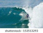 A Surfer Rides A Tube.