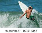 A Surfer Carves A Radical Off...