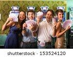 Friends Winning a lot of Money at Casino - stock photo