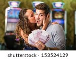 Happy Couple after Winning Money at Casino - stock photo