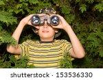 school aged boy looks through... | Shutterstock . vector #153536330