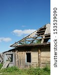 Small photo of Ruins of an abounded wooden house in a village