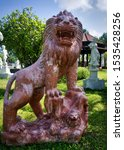 A Powerful Red Marble Lion....