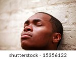 a young man closes his eyes... | Shutterstock . vector #15356122