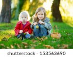 two little sisters playing... | Shutterstock . vector #153563690