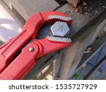 Small photo of Tighten a bolt using an adjustable wrench