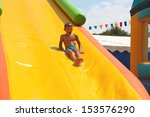 enthusiastic kid on slide in... | Shutterstock . vector #153576290