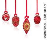 Small photo of Luxury red and gold christmas tree bauble decorations with bows and ribbons on white background with reflection and copy space.